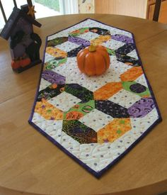 I love Halloween fabric and this runner reflects a selection of my fabric stash. This beautiful ribbon runner highlights the purples, oranges