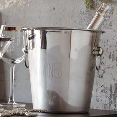 Need to get a nice ice bucket. This one from West Elm is cute. I think I would engrave something fun instead of my name. Like...Bottoms Up! or Bubbly! or Cheers!