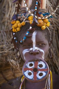 20026.  Woman with lip plate, Mursi tribe, Omo River Valley, Ethiopia