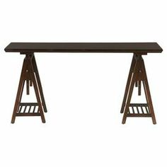 """Showcasing a sawhorse-style base, this handsome desk brings rustic appeal to your office or makes an eye-catching console table in the living room.  Product: DeskConstruction Material: Hardwood solids Color: CherryFeatures: Sawhorse style baseTwo lower shelves Top mounting brackets are adjustable Dimensions: 30.25"""" H x 52"""" W x 24"""" D"""