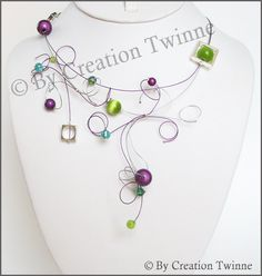 Cute necklace, but what I love most about it are the colors! Purple, green, and turquoise - my favorites! So beautiful together.