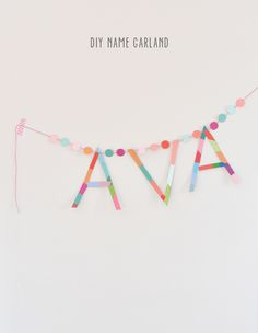 Arty way for kids to learn how to spell their name -> Paint chip name garland project - DIY craft for kids - SmallforBig.com
