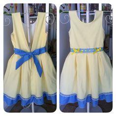 Amarillo y celeste, combinación perfecta para este adorable vestidito de la marca Creativa industria boliviana