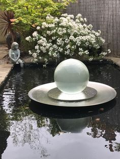 Sharing peace ☮️ and tranquility 🌿 from this charming backyard pond in the UK. Own your own today: www.allisonarmour.com  #spherefountain #gardendesign #gardenart #landscapedesign #waterfountain #waterfeature #luxurydesign #luxuryliving #gardendesignmag #orbfountain #gardensculpture #outdoorlivingspace #luxe #homesandgardens #houseandgarden #betterhomesandgardens #outdoorfountain #indoorfountain #gardenfountain #gardenwaterfeature #aqualens #allisonarmour #allisonarmourart Landscape Design, Garden Design, Indoor Fountain, Water Features In The Garden, Greenhouse Gardening, Ponds Backyard, Better Homes And Gardens, Garden Sculpture, Garden Ideas
