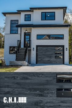 Can you believe this door is made of STEEL? This is our newest woodtone, Carbon Oak on our fan-fave Planks garage door. Explore the most realistic woodtone garage doors in the industry and order your free color samples today! Garage Door Colors, Garage Door Windows, Wood Garage Doors, Windows And Doors, Black Window Frames, Black Windows, Types Of Insulation, Window Types, Planks