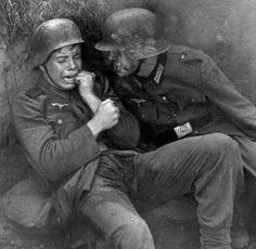 A German soldier tries to comfort a young, terrified soldier during a battle. The young soldier must be 14 or is crying and has wet himself. How scared must he have been? German Soldiers Ww2, German Army, War Photography, Vintage Photography, War Quotes, Military Photos, Men In Uniform, People Of The World, Vintage Pictures