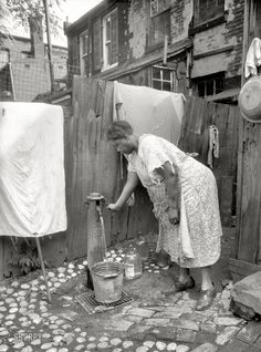 +~+~ Vintage Photograph ~+~+ Woman collecting water for her family from an outside well. Washington 1935.