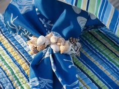 Seashells on an elastic band make such fun napkin rings, after your party your guests can take them home as bracelets!