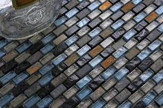 Blue, Black and Silver Glass & Natural Stone Brick Shape Walls Borders Mosaic Tiles Sheet. Create depth and style in your home with this beautiful mosaic. Perfect for adding a touch of texture and warmth whilst still maintaining a luxurious look, these mosaics are ideal for use as small splashbacks or even a feature wall.