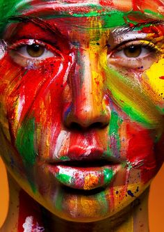 A painted face or a face that has been washed of its makeup to show its real colors?
