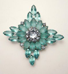 Gorgeous vintage blue navette frosted rhinestone brooch.