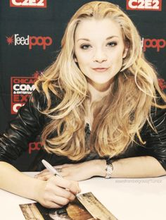Natalie Dormer..she is the beauty:) love her hair