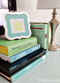 Stacking book in colors you love to help the dvd player blend in... brilliant!