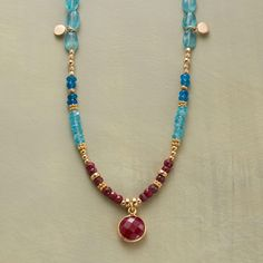 "RUBY BLUES NECKLACE -- Ruby rounds in golden rims are spotlights amid a two-blue mix of apatites, smooth and faceted. Paillettes and a variety of 14kt goldfill beads lend their glow. Toggle clasp. Sundance exclusive handcrafted in USA. 17""L."