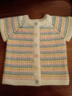 "HUZUR SOKAĞI (Yaşamaya Değer Hobiler) [ ""So sweet Short sleeve Cardi"", ""Love the colours and the buttons to match 💙💚💛"" ] # # # # # Baby Cardigan Knitting Pattern, Baby Hats Knitting, Arm Knitting, Baby Knitting Patterns, Knitting Designs, Knitted Baby Clothes, Kurti Neck Designs, Baby Vest, Baby Sweaters"
