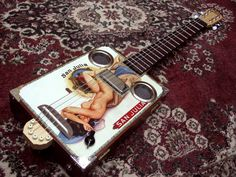 Daddy Mojo Custom gallery Take a look here for images of some very custom projects now in the hands of cigar box guitar enthusiasts...