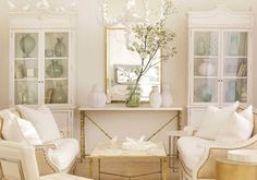 Statement Spaces - Design Chic- love the white and gold decor for a living room!