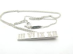 Tiffany & Co. 18k White Gold Atlas Roman Numeral Diamonds Necklace. Get the lowest price on Tiffany & Co. 18k White Gold Atlas Roman Numeral Diamonds Necklace and other fabulous designer clothing and accessories! Shop Tradesy now