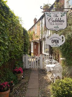Stop for afternoon tea at the gorgeous little Cobbles Tea Room in Rye, East Sussex, England famous for their delicious scones which they have been making for over 60 years. By B Lowe (I love these signs hanging off the side of the buildings) East Sussex, Rye Sussex, The Places Youll Go, Places To Go, Hidden Places, Tee Shop, England And Scotland, English Countryside, Shop Signs
