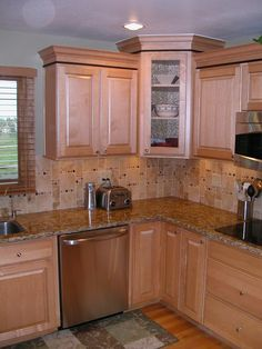 Remodeled kitchen in natural maple