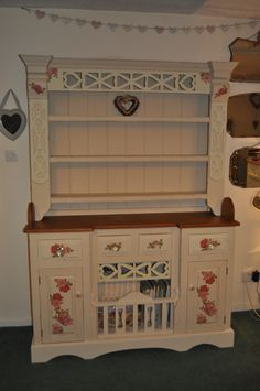 My Welsh dresser which I painted using Autentico chalk paint and added a few decoupaged roses to make it extra pretty :)