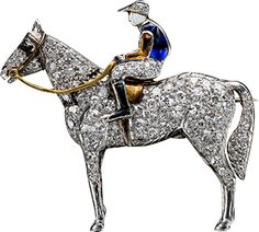 Platinum, gold, diamond, synthetic sapphire, enamel Brooch of horse and jockey. Early 20th century.