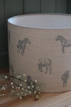 Blue ponies on natural linen fabric available in various sizes from www.rachel-bonas.com