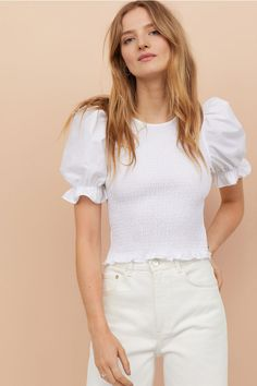 Top in crisp, woven cotton fabric with smocking at front and back. Short puff sleeves, elasticized cuffs with ruffle, and concealed back zip. Fast Fashion, Look Fashion, New Fashion, Fashion News, Womens Fashion, Smocks, Mode Online, Fashion Editor, H&m Tops