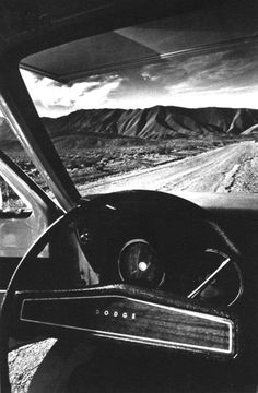Dreams of open roads...  But old  muscle cars aren't so bad, either.