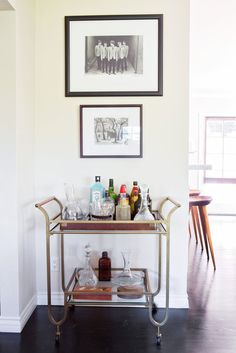 Joey's Stylist To The Stars Digs House Tour | Apartment Therapy - Like that the bottles etc. are corralled in a wooden tray