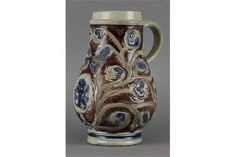 A Westerwald stoneware armorial tankard, 17th/18th century, combed and impressed designs, cobalt