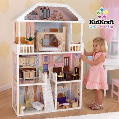 First dollhouse I bought my daughter.  Great starter house and comes with pieces. Perfect for only $ 121 - KidKraft Savannah Dollhouse
