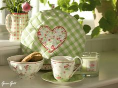 Toaster or tea cozy. Love the heart, and hand embroidery. --GreenGate