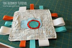 DIY Baby Shower Gifts When you're known for giving creative, DIY gifts to family you run yourself into a problem. You become obligated to bring creative DIY gifts to everything. Sewing Tutorials, Sewing Crafts, Sewing Projects, Sewing Ideas, Sewing Diy, Diy Projects, Tag Blanket Tutorial, Woven Belt, Baby Crafts