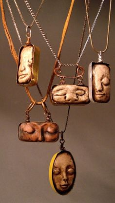 Kristine Kennedy -Vintage watch tins (Elgin, Excelsior, etc) are used to frame these dreaming faces, and oh what they dream.of all those watches and all that time. Polymer clay is used to form the faces and acrylic paint is applied as a patina. Polymer Clay Kunst, Polymer Clay Projects, Polymer Clay Creations, Polymer Clay Sculptures, Jewelry Crafts, Jewelry Art, Handmade Jewelry, Jewelry Design, Designer Jewellery