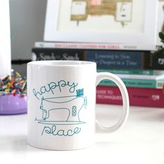 "Is your sewing machine and a cup of coffee or tea your ""happy place""? Then show it some love by using this adorable white coffee mug with a teal or..."