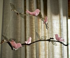 I'm sooooo doing this DYI mobile if I have a girl! It will go great with my flowers, trees, butterflies, and birds theme