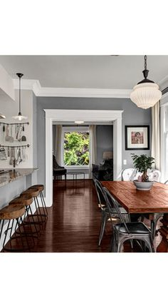 Industrial decor style, darker wood tons w/ gray and tan paints plus white molding