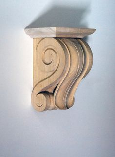 This corbel's sculptural tongue-like motif resembles a lily leaf, while its perfectly executed volutes add masculinity. Overall, this is shorter than our standard corbels, making it perfect for tight