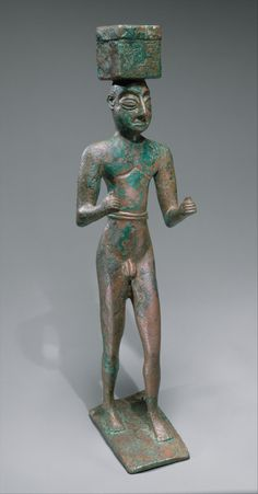 Man carrying a box, possibly for offerings (Metropolitan Museum, NYC)