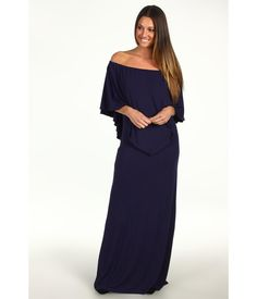 This stunning bib dress will put you in the fashion spotlight.. Elasticized top line.. Tapered wais...