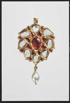 Floral Pendant with Drooping Petals. first half 17th century. Islamic. Floral Pendant with Upswept Petals (first half 17th century, Islamic) Fabricated from gold; worked in kundan technique and set with diamonds, rubies with pendant pearl.