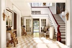 The conventional entrance-hall floor was replaced with lighter Calacatta marble in a parallelogram pattern; 18th-century Sicilian consoles from Newel further animate the space.