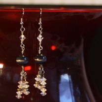 Pretty pair of earrings with black cats eyes and crystals.
