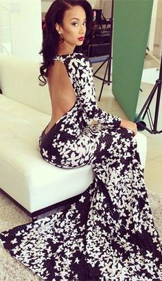 Wow! Now that's a statement dress thanks to the low cutting back. Beautiful!!