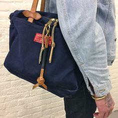 Den & Delve leather knot keychain / Filson bag / tattoo / metal bracelet