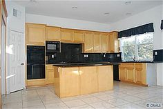 Check out the Homes for Sale in Anaheim, California. Kitchen Island, Kitchen Cabinets, Anaheim California, Homes, Check, Home Decor, Island Kitchen, Houses, Decoration Home