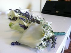 calla lilly, babysbreath and lavender boutineers