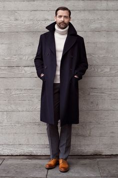 Something as simple as opting for a navy overcoat and grey wool suit pants can potentially set you apart from the crowd. Mix things up by wearing tan leather derby shoes.   Shop this look on Lookastic: https://lookastic.com/men/looks/navy-overcoat-white-turtleneck-grey-dress-pants/21820   — White Wool Turtleneck  — Navy Overcoat  — Grey Wool Dress Pants  — Tan Leather Derby Shoes