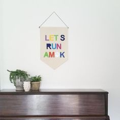 Canvas Wall Banner - Let's Run Amok - Customizable Wall Banner  23 x 16in Wall Hanging Banner - Pennant Flag - Play Room decor by SharpToothStudio on Etsy https://www.etsy.com/listing/201874772/canvas-wall-banner-lets-run-amok
